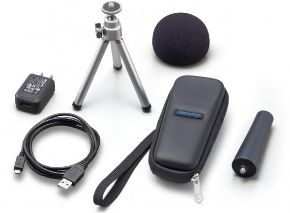 Zoom APH-1n       Zoom APH-1n - acessórios adicionais para o H1n. O pacote inclui windscreen, adaptador de clipe de microfone, tripé de mesa ajustável, estojo flexível, adaptador AC (tipo USB) e cabo USB.